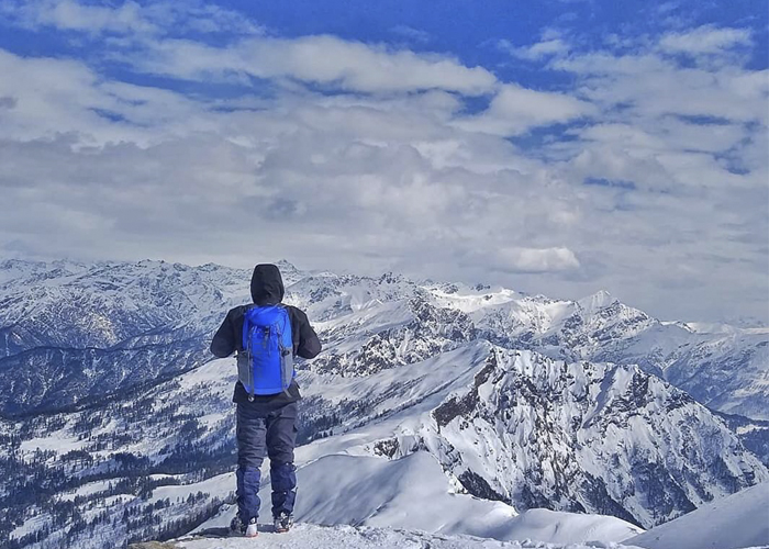 Man admiring beauty of Kedarkantha Summit