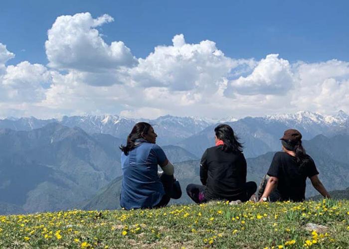 Three girls sitting on Phulara Ridge