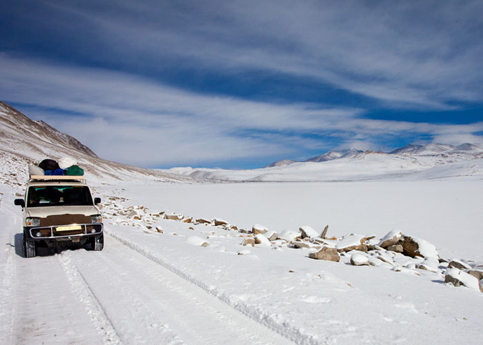 A Jeep Travelling on Snowy highway of Leh