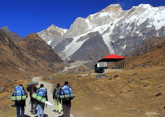 People trekking towards Kedarnath Temple